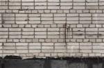 Chain on sloppy brick wall